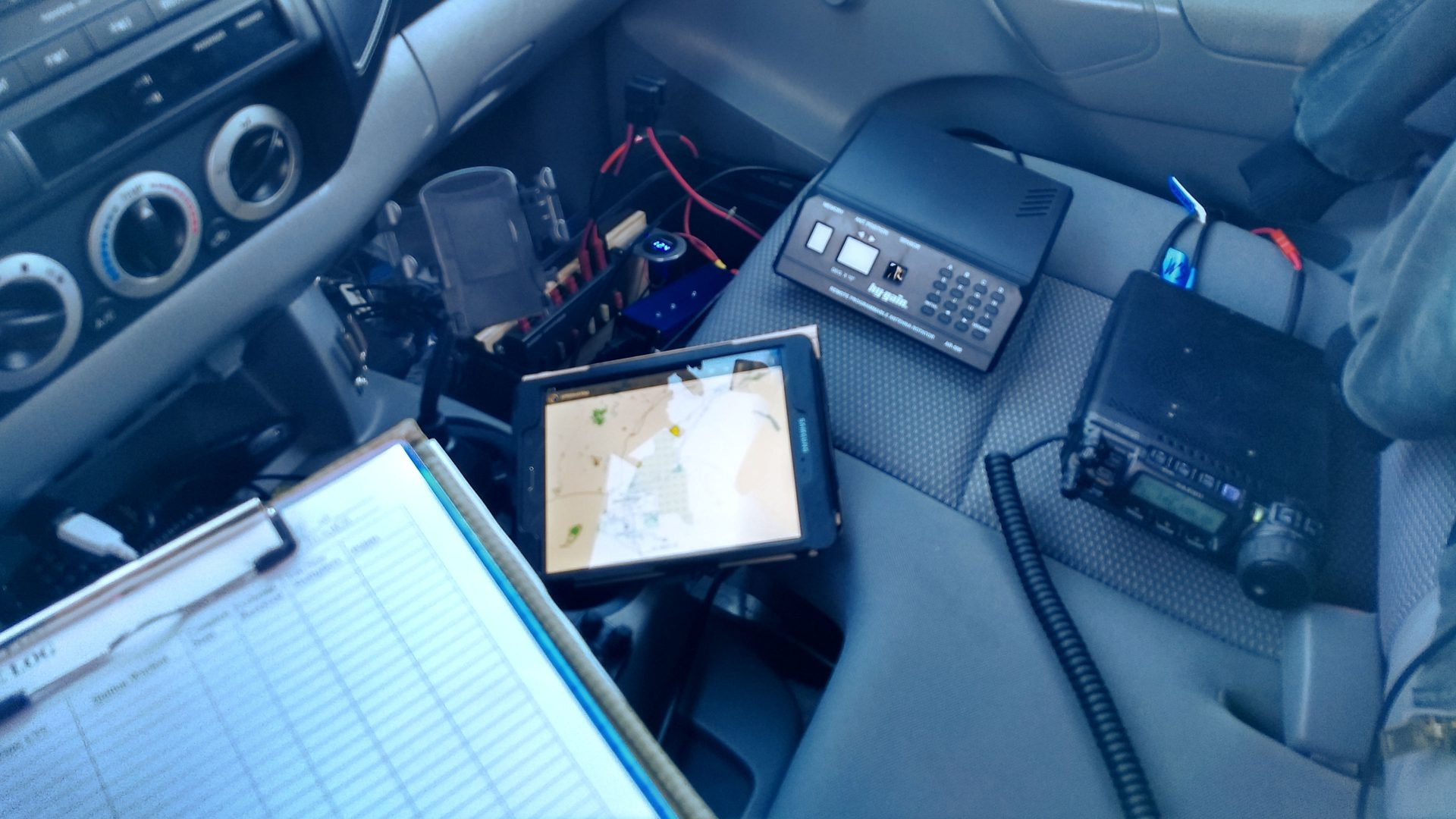 Interior of a truck with a radio, rotator, and tablet