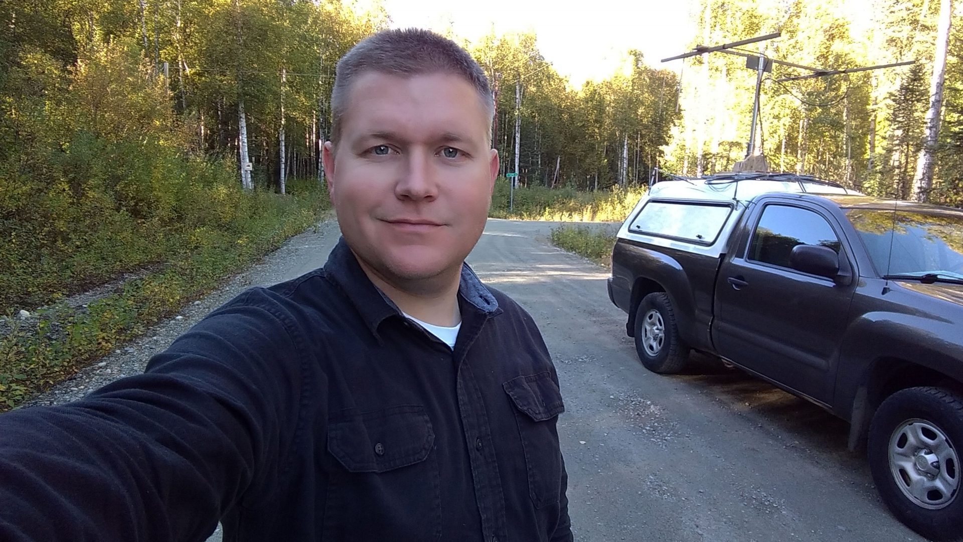 KL7BSC Brandon Clark standing beside VHF rover vehicle