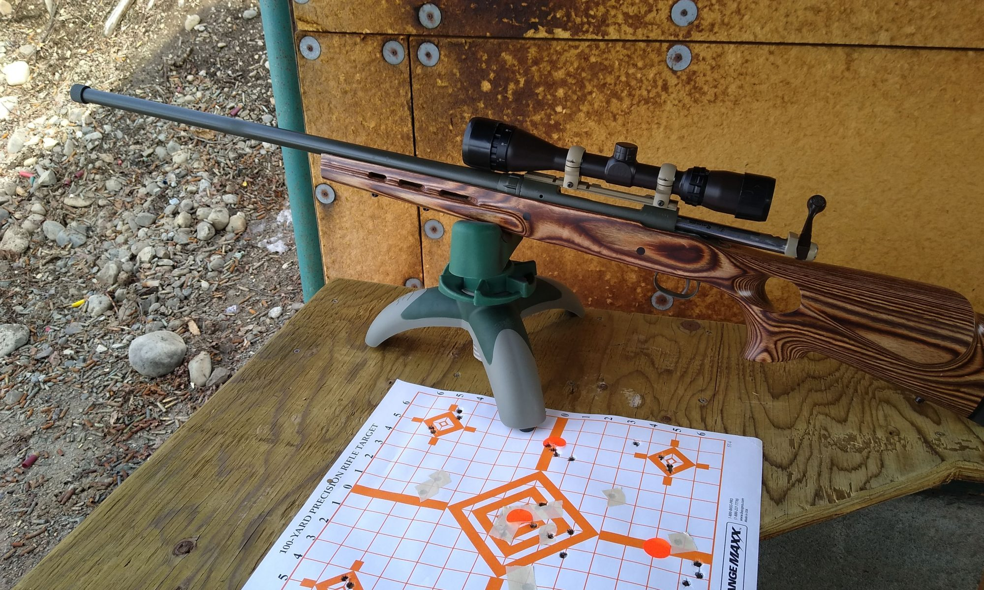 Long range hunting rifle on bench with target