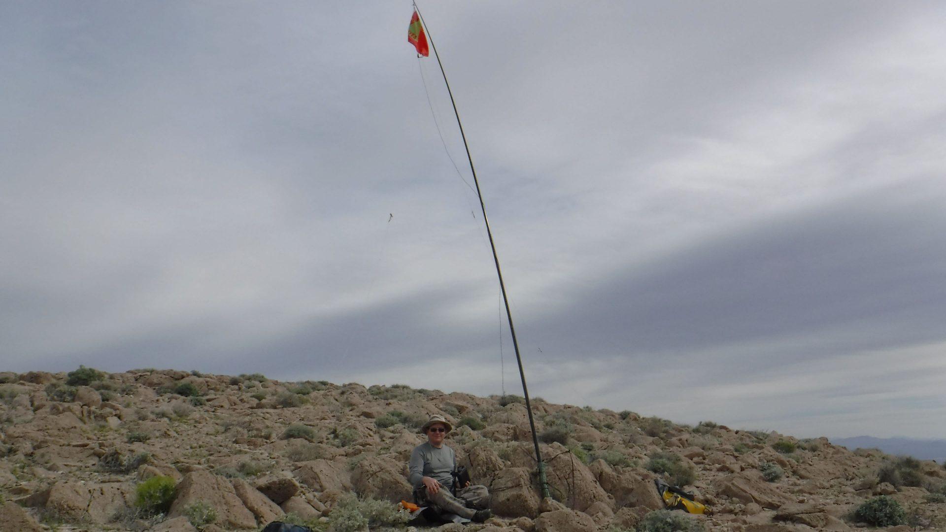 Portable ham radio operator on SOTA peak