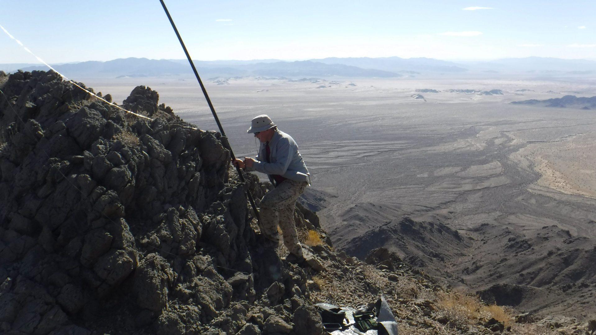 Ham radio operator setting up portable antenna for SOTA
